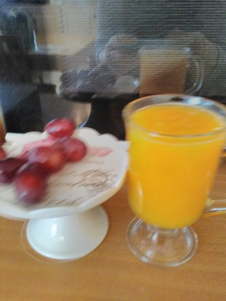 Freshly Squeezed Glass Of Orange Juice From One Orange
